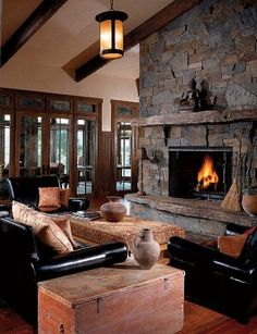 i can see myself relaxing in front of that fireplace.oh yeah. Spanish mission style home. LOVE the stone wall fireplace, and wall of windows nearby Home Fireplace, Fireplace Design, Fireplace Lighting, Craftsman Fireplace, Interior Exterior, Interior Design, Mission Style Homes, Design Living Room, Celebrity Houses