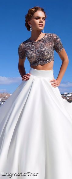 Tarik Ediz Couture. LOVE the plain white skirt, sticking out. SO nice!