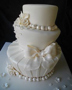 Ivory on Ivory with pearl shimmer wedding cake