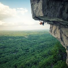 """Photo: @andy_mann // The Shawangunks outside of New Paltz, NY is one of Amercia's oldest and most fascinating climbing areas. Rooted in deep ethical traditions, the nature of the routes here are adventurous and often frightening. The area hosts hundreds of classic, well-protected routes along with some real """"mind-benders."""" // Here, @andywsalo finds himself on the final crux sequence of the Gunks most exposed and difficult line, """"Ozone."""""""