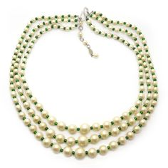 Description A stunning triple row necklace by Christian Dior, signed and dated 1958. The necklace features three rows of beautiful faux pearls, the...
