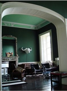 Love this mint green ceiling and hunter green walls