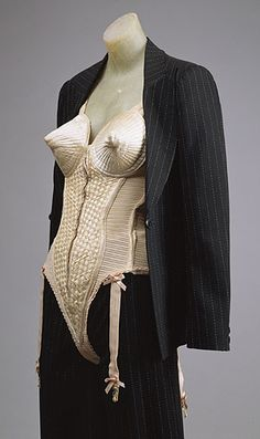 """Suit and Bustier, 1990 Designed by Jean-Paul Gaultier for Madonna in the 1990 """"Blond Ambition"""" World Tour Broken pinstripe slashed jacket and trousers, peach silk/Lycra corset Loan, Madonna Ciccone Metropolitan Museum of Art Costume Institute Madonna Fashion, 90s Fashion, Runway Fashion, Vintage Fashion, Fashion Trends, Fetish Fashion, Gay Costume, Female Pirate Costume, Jean Paul Gaultier"""