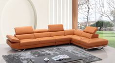 """Divani Casa Quebec Modern Orange Leather Sectional Sofa. The Quebec modern orange leather sectional sofa features a sleek, modern design with tufted leather seats and adjustable headrests for better head positioning. The armrest on the left facing sofa allows you to adjust it to your comfort, while the right facing chaise allows you to stretch your back and legs. Geometrically designed metal legs further magnified its refined appeal. Dimensions: Chaise: W90"""" x D43"""" x H28""""/37""""  3 Seater: W77""""…"""