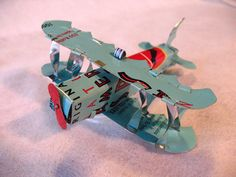 Airplane ornament handmade recycled tin cans by BottleCapWhistles, $25.00