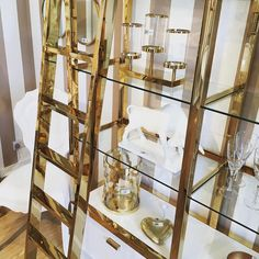 Our chunky gold Immaculee White & Gold Library Shelves Unit comes with a golden ladder so you can not only showcase but reach your treasures. Surely the most glamorous piece you've seen? #beautifulhomes #homedecor #designerlife #goldinteriors #golden #interior #instagood #instacool #picoftheday #interiordesign #design #interiordesigner #interiors #lookbook #love #decor #renovate #renovation #house #homestyle #home #homeinspiration #homeinspo #houseinspo #accessories #luxury #luxurylifestyle…