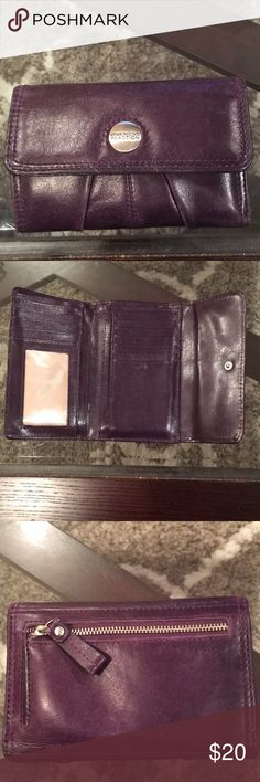 Leather Kenneth Cole Reaction Wallet Leather Kenneth Cole Reaction Wallet. Plum color in genuine leather with ID and cards holders, pocket in the back of wallet for change or extra items.  Gently used. Price reflects some wear.   Measurements: 4x6, closed 6x9 1/2 open Kenneth Cole Reaction Bags Wallets