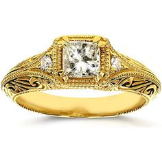 Kobelli 14K Yellow Gold 5/8 ctw Diamond Antique Filigree Engagement Ring Founded in the 1980s and based in Los Angeles Kobelli designs are some of the most magnificent and unique diamond jewelry products in the world. This Kobellis antique style engagement ring features filigree curves and migraine edges etched into solid and sleek 14-karat yellow gold with a highly polished finish. It also showcases a single of princess-cut ⅝ carat center diamond which is accompanied with two…