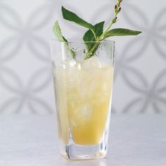 Isle of Islay Swizzle | Smoky single-malt Scotches are almost never used in tropical drinks, but Julie Reiner was sure that one would taste great with passion fruit juice. She garnishes this swizzle with grilled pineapple, to play up the Scotch's smokiness.