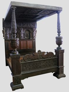 "PART 17TH CENTURY OAK FOUR POSTER BED, the panelled and heavily carved head with term figures, panelled and strapwork moulded roof, massive carved and moulded cup and cover pillar supports to the foot with a moulded and carved panel. Together with mattress. 70"" Wide max x 87"" max.   CONDITION REPORT;  Some panelling is period 17th century, mostly Victorian. Estimate: £1,500 - £2,500"