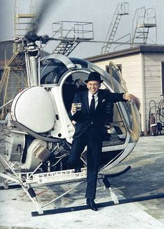 Frank - Showing up like a boss in a helicopter with a drink in hand.