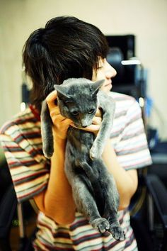 whenever I see pictures of him and his cats it makes me super happy