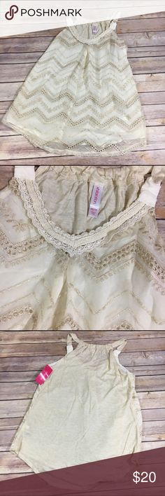 NEW NWT Xhilaration Cream Gold Lace Tank XS NEW NWT Xhilaration Cream Gold Lace Tank XS  Beautiful tank.  New with tags.  Beigey tank with cream and gold lace overlay.  You will love it. Xhilaration Tops Tank Tops