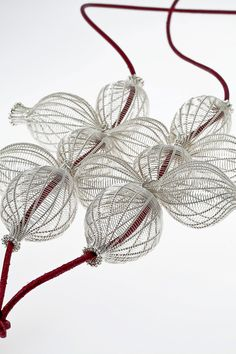 Maja Houtman. Pendant: Nine, 2012. Silver, leather. 12 x 12 x 3 cm.