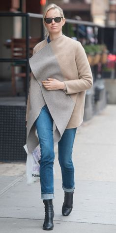 Karolina Kurkova shows us how to rock a blanket coat in slim denim and buckle-detail boots.