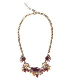 Red statement bib necklace studded with faux rhinestones.    Length of necklace chain: 18 inches to 20 inches (adjustable length)    Purchase 4