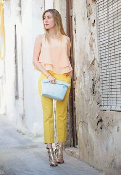 yellow pants with peach top and gold heels