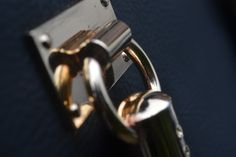 a close up of a gold hand bag handle