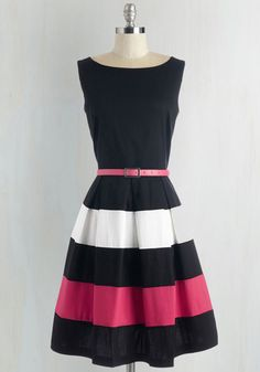 Bear witness to the brilliance that is this black dress! Boldly designed with white and bright pink bands on its box pleated skirt, this belted frock is a scintillating statement of style.