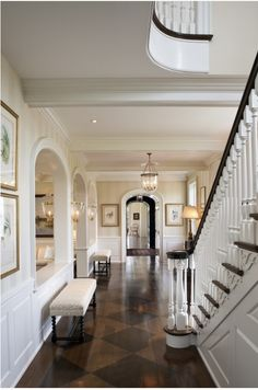 Front hall - banister, chair rail, stripes