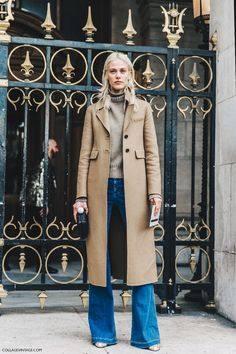 Flare jeans, long camel coat.
