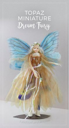 Topaz the dream Fairy. A beautiful addition to add to your miniature fairy collection. Topaz wears an incredible oyster fairy gown with sequin details, butterfly wings with a hand dyed silk sash in shades of peony and rose.
