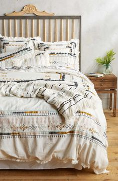Bring a bit of globally inspired style to your bedroom décor with this crisp cotton duvet cover featuring geometric embroidery and tassel embellishments.