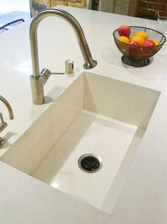 Integral Sink: If you'd rather your kitchen sink blend in, and you are installing stone, metal, solid surface or quartz countertops, think about having an integral sink fabricated. Your countertop fabricator simply forms a sink using the countertop material. The look is very clean and seamless — perfect for a contemporary kitchen. (larger pic on last pin.)