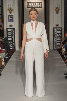 "Lenie Boya ""Dramatique"" Collection at London Fashion Week S/S 2016 Haute Couture. White crepe asymmetric and futuristic jumpsuit"