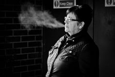 Taking a breath  Keep Clear  Candid street portrait taken in Glasgow, Scotland. © Leanne Boulton