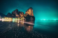 At night in Railay Beach, Thailand fishing boats turn on their lights creating an artificial Aurora effect.