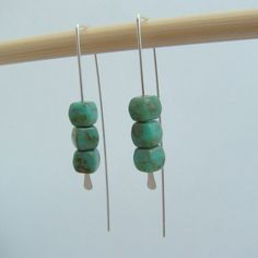 Silver turquoise earrings. Love the simplicity.