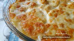 Krompir u kombinaciji sa bijelim lukom i vrhnjem za kuhanje,zapečen sa sirom i susamom.