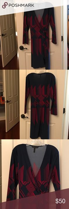 BCBGMaxazria wrap dress in dark blue & raspberry Comfortable wrap dress with raspberry linear designs on front and back. Small tie inside of dress and larger tie outside of dress. Size L. Happy to try on if you are interested. Offers welcome! BCBGMaxAzria Dresses