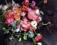 Saipua stunner.  love the shape and composition of this bouquet. The colors are fantastic! Like a sunset.