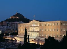 It is one of Athens' busiest areas, buzzing with life at all times! It features lots of sights, including the Parliament building where you can see the changing of the guards, which happens every hour, restaurants, shops, hotels and more! #Syntagma #athens #Greece #Monterrasol #travel #tour #destination #tourism #beauty #architecture #Lycabettus Seaside Village, Far Away, Fishing Boats, Countryside, Tourism, Athens Greece, Island, Explore, Mansions