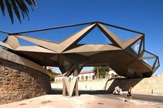 This ultra-futuristic pedestrian bridge fashioned from hexagonal steel framing and paving links two uneven areas of Motril, Spain. The structure connects the gardens of the Explanadas and the Park Pueblos de las Américas, simultaneously freeing up the busy Avenue Virgen de la Cabeza. Spotted over on Evolo, this unusual bridge by Gijon Arquitectura is enclosed by opaque panels and includes strips of LED lights that illuminate the way at night.