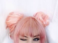 Cute Peach and Pink hairstyle with buns - http://ninjacosmico.com/28-crazy-hairstyles-ideas/