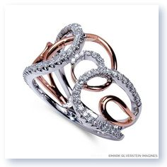 Like your love for one another, the loops in this stunning fashion ring never end.  Diamonds line the 18K white gold in an elegant journey while polished 18K rose gold stems from the base and grows upwards in an intricate pattern that compliments and encompasses the white gold and diamonds.