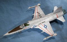 This aircraft paper model is a Northrop Freedom Fighter, a supersonic light fighter, the papercraft is created by Paper Aircraft Models, and the scale Paper Airplane Models, Model Airplanes, Paper Models, Paper Planes, Papercraft Download, Paper Aircraft, Paper Art, Paper Crafts, Paper Magic