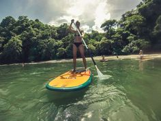 Stand up paddling surf in Jacó Beach, Costa Rica