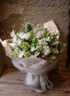 lilas, menthe, narcisse, pois de senteur, romarin, tulipe...beautifully wrapped with music paper