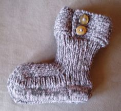 Moon Socks. View 1. Slippers made with free pattern from Garnstudio. Knitted using 2 strand method. Yarn: Drops Nepal (wool and alpaca blend) from Garnstudio. Real horn buttons. Free pattern available here: www.garnstudio.co...