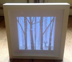 Shadow box made with my Silhouette Cameo , card and vellum