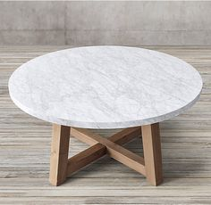 "RH's Salvaged Wood & Marble Beam Round Dining Table:Our table pairs a 2""-thick marble top with the natural beauty of solid salvaged pine timbers from 100-year old European buildings."