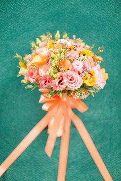 cheery bouquet, photo by Peter and Veronika http://ruffledblog.com/pastel-slovak-wedding #flowers #bouquets #wedding