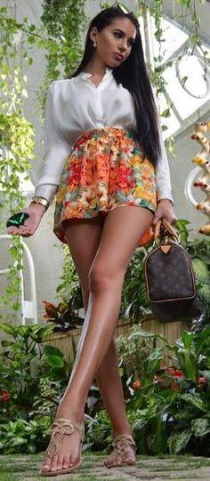 White Silk Blouse + Floral Shorts                                                                             Source