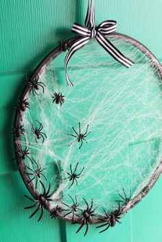 A DIY spider web wreath, made from an embroidery hoop, adds spooky Halloween charm to your front door. Crafts to sell 65 Easy Halloween Crafts You Can DIY to Haunt Your Home This Season Deco Haloween, Soirée Halloween, Adornos Halloween, Easy Halloween Crafts, Outdoor Halloween, Halloween Recipe, Women Halloween, Halloween Season, Halloween Makeup