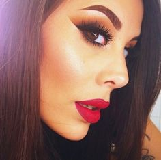 Bold red lipstick with sharp brown smokey eyes