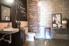 The bathroom includes a chalkboard wall complete with a custom mural created by a professional chalkboard a...